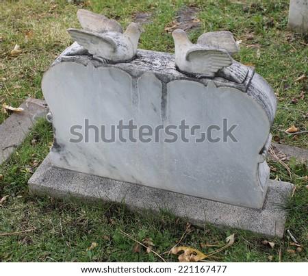 Old Double Broken Marble Doves Headstone - stock photo