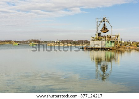 Old dredger in the gravel pit water.  - stock photo