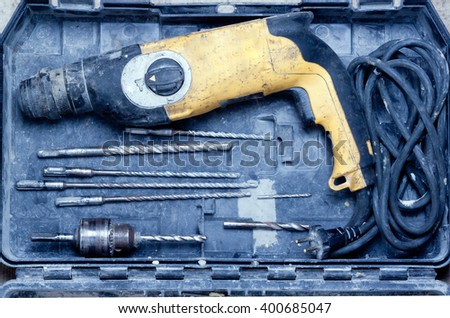 old drill and drill bits are in the box.view from above.toned - stock photo