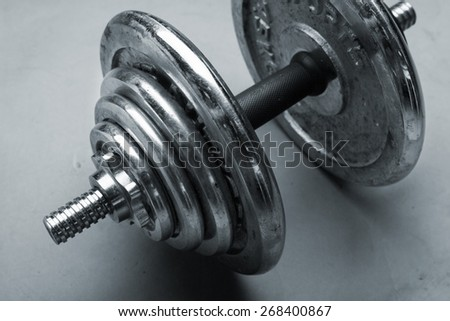 Old dumbbells weight - stock photo