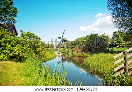 Old dutch village in country side - stock photo