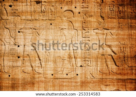 old egypt hieroglyphs carved on the stone with papyrus scratches - stock photo
