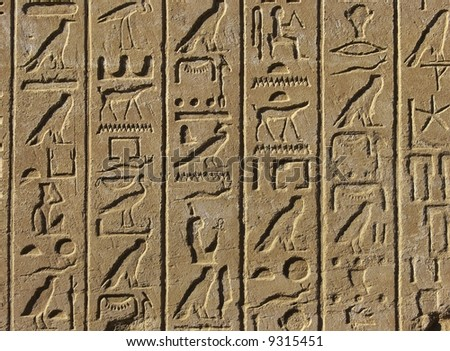 Old egyptian basrelief and hieroglyphs background - stock photo