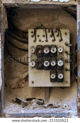 Old electric board in a residential building - stock photo