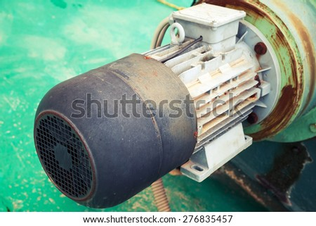 Old electric engine fragment, selective focus, shallow DOF, vintage toned photo with old style filter effect - stock photo