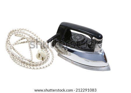 old electric iron and electric wire on a white background. viewed from above - stock photo