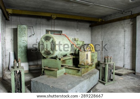 Old electric motor in a ruin  - stock photo