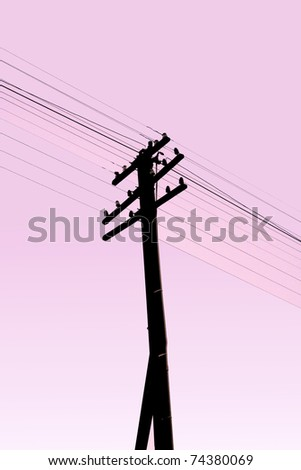 Old electric pillar and cable silhouette with purple sky,Thailand - stock photo