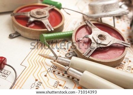 old electronic components on circuit - stock photo