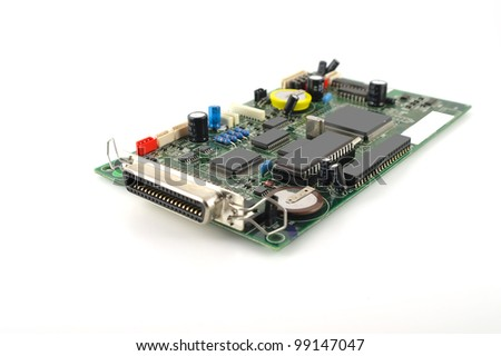 Old electronics circuit board for printer over white. Shallow DOF. - stock photo