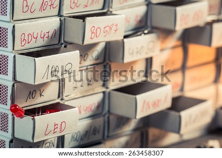 Old electronics components in physics lab - stock photo