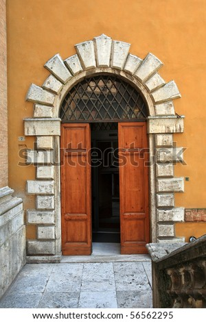 Old elegant door front view Tuscan Italy - stock photo
