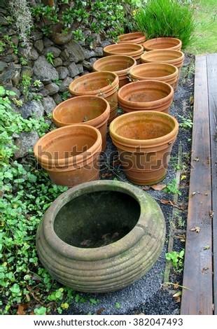 Old empty flower pots in a garden - stock photo