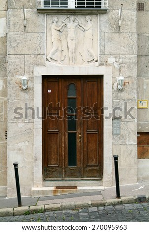 Old entrance door with wooden ornaments. - stock photo