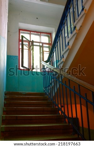 old entrance stairs in the stairwell of an apartment house - stock photo