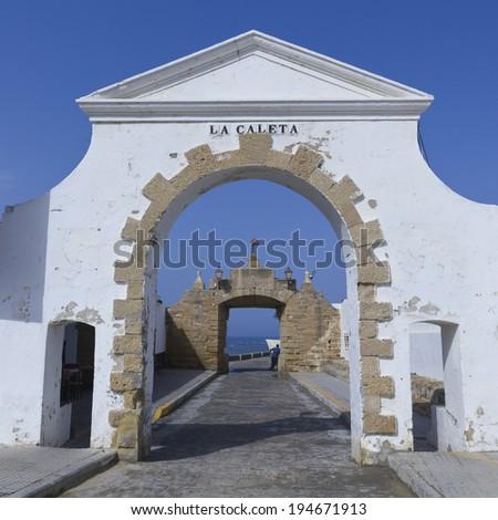Old entrance to the Caleta beach in Cadiz, Andalucia, Spain - stock photo
