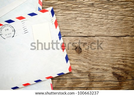 Old envelope on wooden background - stock photo