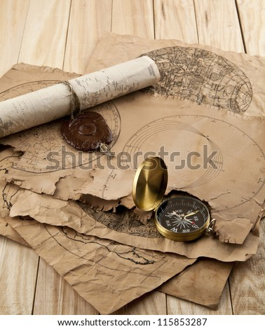 old envelopes and compass on a table - stock photo