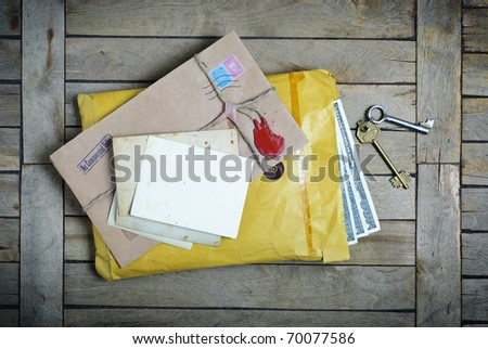 Old Envelopes with empty photos on a vintage wooden table - stock photo
