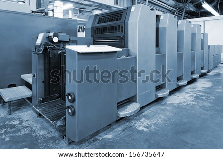 old equipment for printing in a modern printing house - stock photo