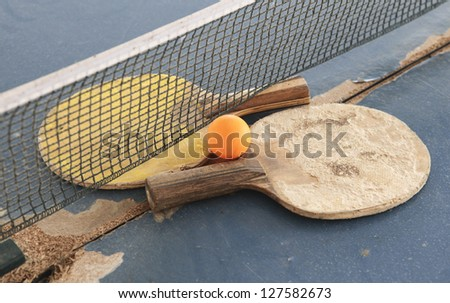 Old Equipment for table tennis - racket, ball, table - stock photo