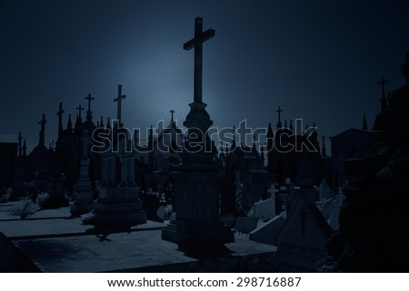 Old European cemetery at night - stock photo