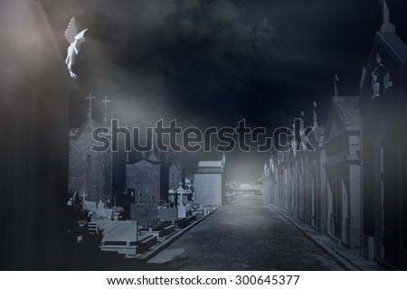 Old european cemetery in a misty night - stock photo
