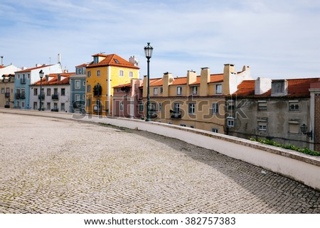 Old european street and colored houses. Lisbon, Portugal - stock photo