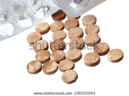 old expired pills and empty packaging on a white background - stock photo