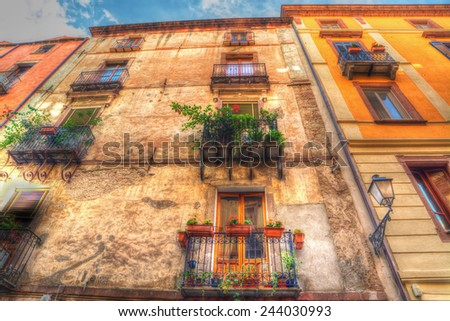 old facades in Bosa, Italy. Processed for hdr tone mapping effect. - stock photo
