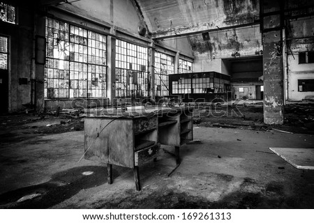 old factory inside black and white - stock photo