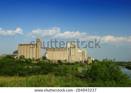 Old factory with silo tanks for corn - stock photo