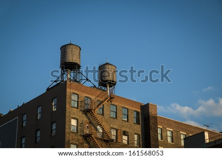 Old factory with water towers on roof, New York City - stock photo
