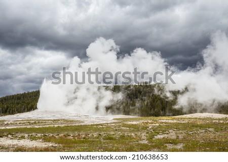 Old Faithful Geyser in Yellowstone National Park - stock photo