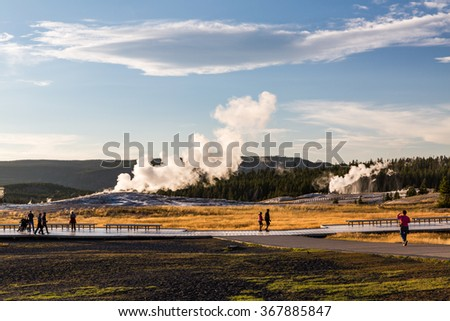 Old Faithful Geyser in Yellowstone National Park, USA - stock photo