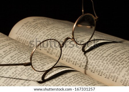 Old Family Bible with eyeglasses - stock photo