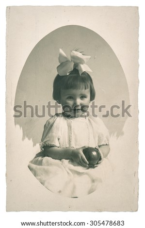 Old family photo portrait of little girl with toy ball from ca. 1950 - stock photo