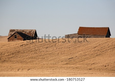 Old farm buildings on the Prairie - stock photo