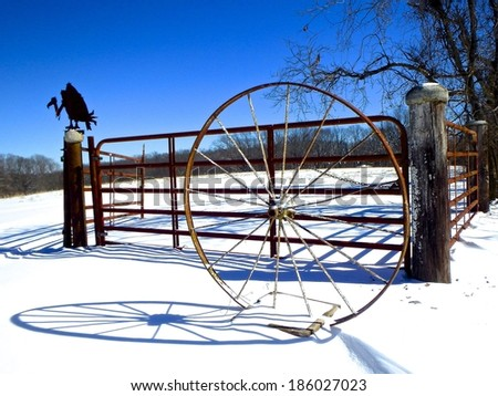 Old farm gate in snow, rural Arkansas/Vigilant Sentinel/Polar Vortex and the Vulture - stock photo