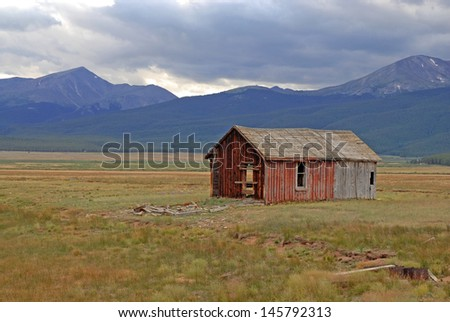 Old Farm House, Rocky Mountains in the American West - stock photo