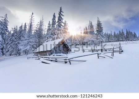 Old farm in the mountains at winter - stock photo