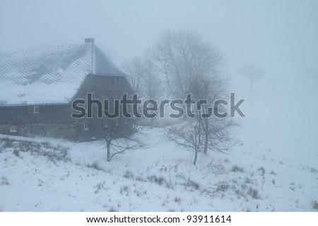 old farm in winter - stock photo