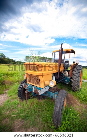 Old farm tractor - stock photo