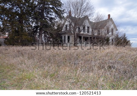 Old Farmhouse with grass - stock photo