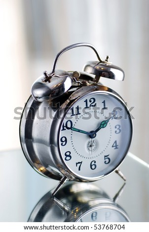 Old fashion alarm clock in the morning light - stock photo