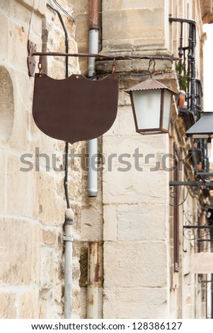 Old fashion street lamp with cafe or bar sign on white - stock photo