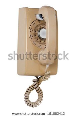 Old fashioned beige wall phone, isolated - stock photo