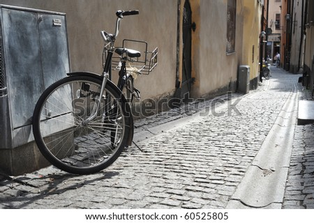 Old fashioned bicycle on old Stockholm street - stock photo