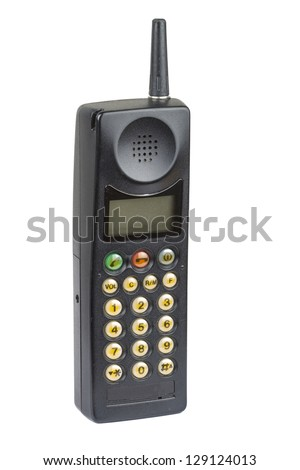 Old fashioned black mobile phone on plain background - stock photo