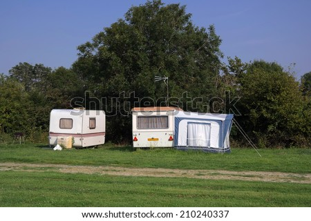 Old-fashioned caravans at farm campsite in Normandy, France - stock photo